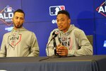 Minnesota Twins Eddie Rosario, left, listens as Jorge Polanco answers a question from the media Tuesday, Oct. 1, 2019, in Minneapolis as the Twins prepare for the American League Division Series baseball playoffs. The Twins and Yankees play Game 1 of a best-of-five series on Friday in New York. (AP Photo/Jim Mone)