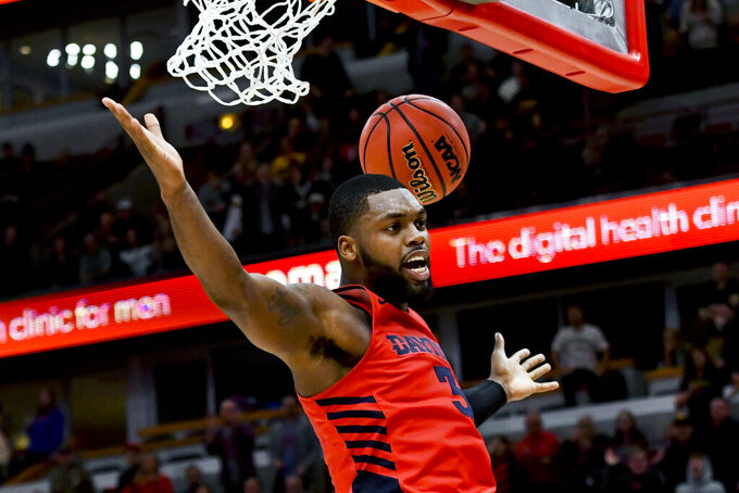 "FILE - In this Dec. 21, 2019, file photo, Dayton guard Trey Landers (3) scores in the second half of an NCAA college basketball game against Colorado, in Chicago. This will always be remembered as the Final Four that never was, called off because of the coronavirus outbreak and one of the most sobering reminders of what this pandemic has cost the world of sports. ""I wish that all of this was just a dream I could wake up from,"" senior guard Trey Landers tweeted after the shocking word came down three weeks ago that the season was over. ""Wish I could play one more game with my brothers."" (AP Photo/Matt Marton, File)"