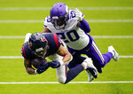 Houston Texans wide receiver Will Fuller (15) makes a catch for a first down in front of Minnesota Vikings cornerback Jeff Gladney (20) during the second half of an NFL football game Sunday, Oct. 4, 2020, in Houston. (AP Photo/David J. Phillip)
