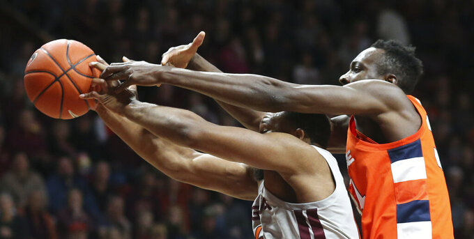 Virginia Tech's P.J. Horne (14) is fouled from behind by Syracuse's Bourama Sidibe (34) as they battle for a rebound during the first half of an NCAA college basketball game in Blacksburg Va., Saturday, Jan. 18 2020. (Matt Gentry/The Roanoke Times via AP)