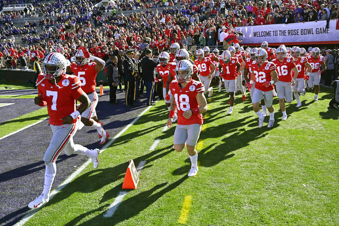 Ohio State runs onto the field for warm ups before the Rose Bowl NCAA college football game against Washington Tuesday, Jan. 1, 2019, in Pasadena, Calif. (AP Photo/Mark J. Terrill)