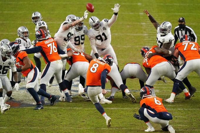 Las Vegas Raiders block a field goal attempt by Denver Broncos kicker Brandon McManus (8) during the first half of an NFL football game, Sunday, Jan. 3, 2021, in Denver. (AP Photo/Jack Dempsey)