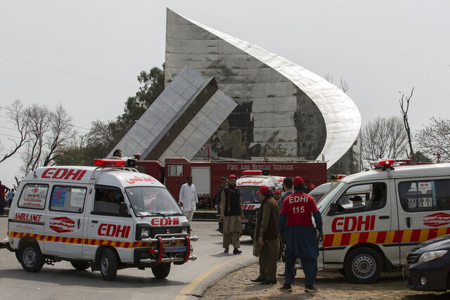 Ambulances and fire brigade arrive near the site of a plane crash in Islamabad, Pakistan, Wednesday, March 11, 2020. Pakistan's air force says one of its fighter jets has crashed in a wooded area near the capital while practicing aerobatic maneuvers. Wednesday's crash was in preparation for National Day celebrations later this month. (AP Photo/B.K. Bangash)