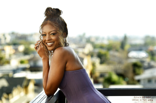 """Actress Javicia Leslie poses for a portrait, Monday, Jan. 4, 2021, in Glendale, Calif. Leslie will star as the caped crusader on CW's """"Batwoman,"""" which premieres its second season on Jan. 17, 2021. (AP Photo/Chris Pizzello)"""