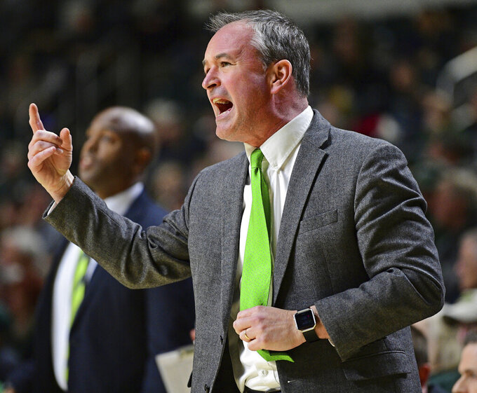 Ohio coach Saul Phillips calls a play during the first half of the team's NCAA college basketball game against Buffalo, Tuesday, March 5, 2019, in Athens, Ohio. (AP Photo/David Dermer)