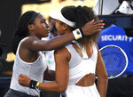 Coco Gauff, left, of the U.S. is congratulated by Japan's Naomi Osaka after winning their third round match at the Australian Open tennis championship in Melbourne, Australia, Friday, Jan. 24, 2020. (AP Photo/Lee Jin-man)
