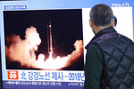 A man watches a TV screen showing a file image of North Korea's missile launch during a news program at the Seoul Railway Station in Seoul, South Korea, Wednesday, Jan. 1, 2020. Kim accused the Trump administration of dragging its feet in nuclear negotiations and warned that his country will soon show a new strategic weapon to the world as it bolsters its nuclear deterrent in the face of
