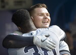 New York Yankees designated hitter Luke Voit, right, embraces teammate Cameron Maybin in the dugout after hitting a home run against the Toronto Blue Jays in the sixth inning  of a baseball game in Toronto, Saturday, Sept. 14, 2019. (Fred Thornhill/The Canadian Press via AP)
