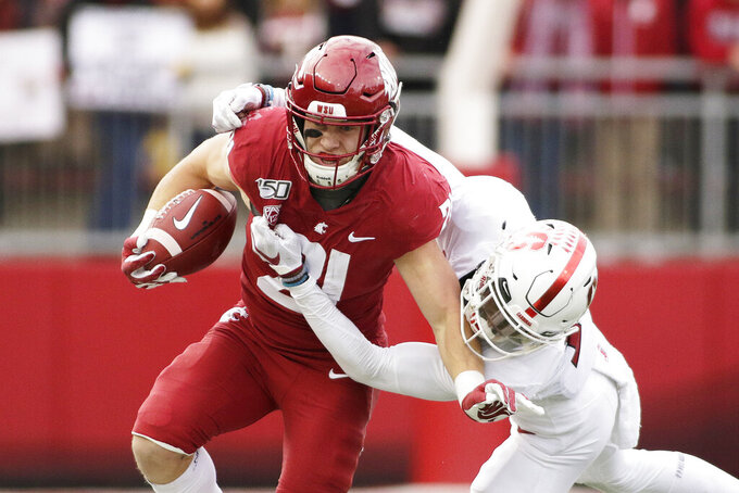 Washington State running back Max Borghi, left, carries the ball while pressured by Stanford cornerback Kyu Blu Kelly during the first half of an NCAA college football game in Pullman, Wash., Saturday, Nov. 16, 2019. (AP Photo/Young Kwak)