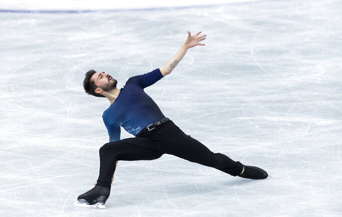 FILE - In this April 16, 2021 file photo France's Kevin Aymoz performs during the men's free skating program of the ISU World Team Trophy figure skating competition in Osaka, western Japan. Six French athletes have spoken about being gay and shared difficult experiences they had during their formative years, among them Kevin Aymoz. (AP Photo/Hiro Komae, File)