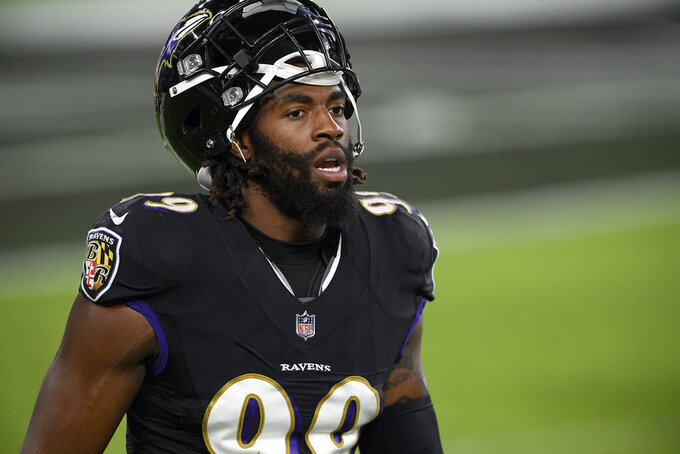 FILE - In this Sept. 28, 2020, file photo, Baltimore Ravens outside linebacker Matt Judon looks on before an NFL football game against the Kansas City Chiefs in Baltimore. A person familiar with the deal says the New England Patriots have agreed to sign edge rusher Judon to a four-year, $56 million deal for the former Ravens standout who totaled 15 1/2 sacks in earning back-to-back Pro Bowl selections. (AP Photo/Nick Wass, File)