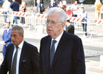 Former Italian Premier Mario Monti, right, arrives for a commemorative Mass for late CEO Sergio Marchionne in Turin's cathedral, Italy, Friday, Sept. 14, 2018. The heir to Fiat's founding family has paid an emotional farewell to the late CEO Sergio Marchionne, who died suddenly in July, saying
