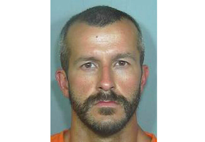 FILE - This undated file photo from the Weld County Sheriff's Office shows Chris Watts, who pleaded guilty in the deaths of his pregnant wife, 34-year-old Shanann Watts, and their two daughters, 4-year-old Bella and 3-year-old Celeste. Documents show Watts has acknowledged to investigators that he strangled his wife in their bed then drove her body and the girls to a worksite, where he smothered the girls using a blanket.  Watts made the statements during a prison interview with detectives three months after he was sentenced to life in prison. Authorities said they believe the grim details represent Watts' first full confession.(Weld County Sheriff's Office via AP, File)