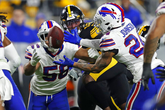 Buffalo Bills outside linebacker Matt Milano (58) and cornerback Taron Johnson (24) go after a turnover by the Pittsburgh Steelers during the first half of an NFL football game in Pittsburgh, Sunday, Dec. 15, 2019. The Bills recovered the ball. (AP Photo/Keith Srakocic)