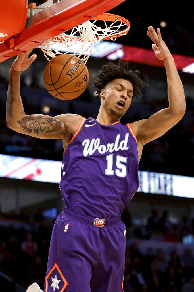 World forward Brandon Clarke, of the Memphis Grizzlies, dunks against the U.S. during the first half of the NBA Rising Stars basketball game in Chicago, Friday, Feb. 14, 2020. (AP Photo/Nam Y. Huh)
