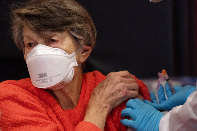 Renee Dunn, 84, gets the coronavirus vaccine at a clinic organized by New York City's Department of Health, Monday, Jan. 11, 2021.