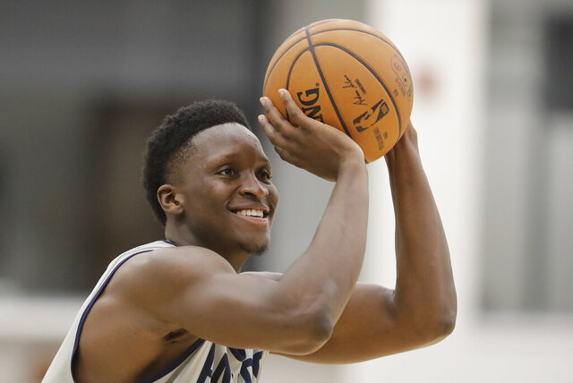 FILE - In this Jan. 28, 2020, file photo, Indiana Pacers' Victor Oladipo shoots during practice at the team's NBA basketball training facility in Indianapolis.  Oladipo was rounding into form when the NBA suddenly stopped. His expected increase in playing time, his hopes of chasing a home playoff series and taking the Indiana Pacers on a deep postseason run went on hold — at least a few more weeks. (AP Photo/Darron Cummings, File)