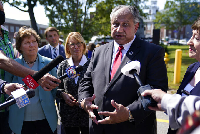 Navy Secretary Carlos Del Toro speaks to reporters following a groundbreaking ceremony for a $1.7 billion dry dock project at Portsmouth Naval Shipyard, Wednesday, Sept. 8, 2021, in Kittery, Maine. (AP Photo/Robert F. Bukaty)