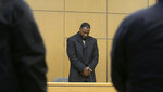 Former NCAA college football player Torrey Green stands as he waits for the jury to enter the courtroom during his rape trial, Tuesday, Jan. 15, 2019, in Brigham City, Utah. Green is accused of raping multiple women while he was a football player at Utah State. (Eli Lucero/The Herald Journal via AP)