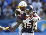 Los Angeles Chargers defensive back Brandon Facyson breaks up a pass intended for Houston Texans wide receiver Will Fuller (15) during the second half of an NFL football game Sunday, Sept. 22, 2019, in Carson, Calif. (AP Photo/Marcio Jose Sanchez)