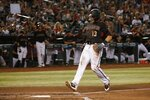 Arizona Diamondbacks' Nick Ahmed scores a run against the Cincinnati Reds during the third inning of a baseball game, Saturday, Sept. 14, 2019, in Phoenix. (AP Photo/Ross D. Franklin)
