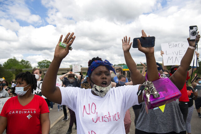 Protesters march in the streets towards U.S. 23 and cross into Ann Arbor, Mich., Thursday, May 28, 2020, during a protest for Sha'Teina Grady El, an Ypsilanti woman who was punched repeatedly in the head by a Washtenaw County Sheriff's deputy last weekend. (Nicole Hester/Ann Arbor News via AP)