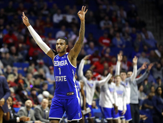 Georgia State's Damon Wilson celebrates after making a 3-point basket during the first half of a first round men's college basketball game against Houston in the NCAA Tournament Friday, March 22, 2019, in Tulsa, Okla. (AP Photo/Jeff Roberson)