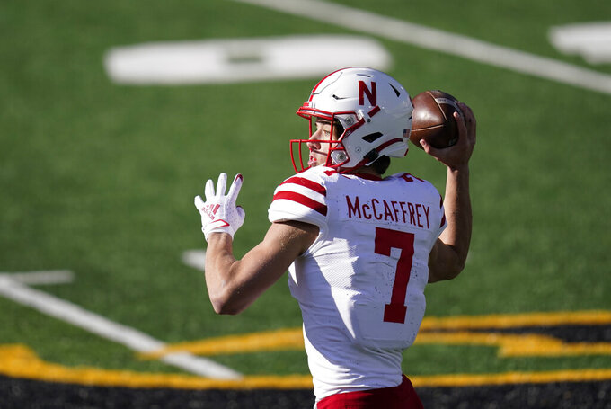 Nebraska quarterback Luke McCaffrey throws a pass during the first half of an NCAA college football game against Iowa, Friday, Nov. 27, 2020, in Iowa City, Iowa. (AP Photo/Charlie Neibergall)