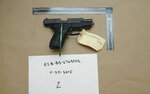 This evidence photo from the criminal complaint of the U.S. District Court for Massachusetts v. Ashley Bigsbee for illegal possession of a stolen firearm on Nov. 15, 2015, in Suffolk, Mass., shows one of ten M11 semiautomatic handguns that former Army Reserve member James Morales stole from the Lincoln Stoddard Army Reserve Center in Worcester, Mass. (U.S. District Court for Massachusetts via AP)