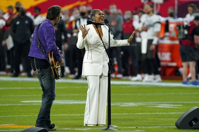 Eric Church and Jazmine Sullivan performs the national anthem before the NFL Super Bowl 55 football game between the Kansas City Chiefs and Tampa Bay Buccaneers, Sunday, Feb. 7, 2021, in Tampa, Fla. (AP Photo/Mark Humphrey)