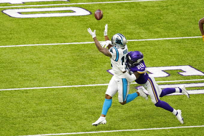Minnesota Vikings cornerback Jeff Gladney (20) breaks up a pass intended for Carolina Panthers wide receiver DJ Moore (12) during the first half of an NFL football game, Sunday, Nov. 29, 2020, in Minneapolis. (AP Photo/Charlie Neibergall)