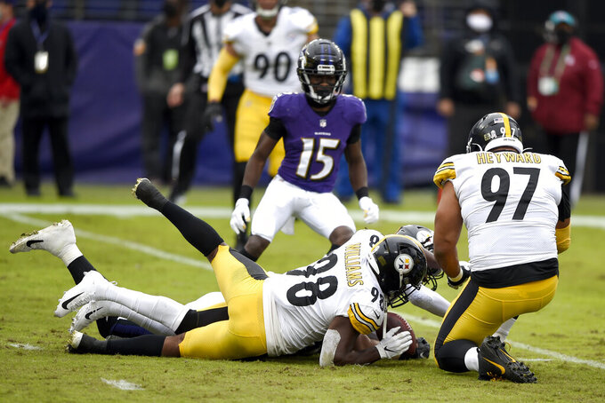 Pittsburgh Steelers inside linebacker Vince Williams (98) recovers a fumble by Baltimore Ravens quarterback Lamar Jackson, not visible, during the first half of an NFL football game, Sunday, Nov. 1, 2020, in Baltimore. (AP Photo/Gail Burton)