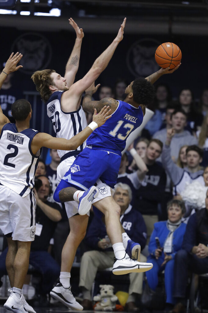 Seton Hall's Myles Powell (13) shoots over Butler's Joey Brunk (50) during the first half of an NCAA college basketball game, Saturday, Feb. 2, 2019, in Indianapolis. (AP Photo/Darron Cummings)