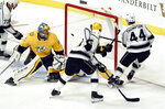 Los Angeles Kings center Nate Thompson (44) scores a goal against Nashville Predators goaltender Pekka Rinne (35), of Finland, during the second period of an NHL hockey game Saturday, Nov. 17, 2018, in Nashville, Tenn. (AP Photo/Mark Zaleski)