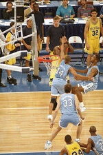 FILE - In this April 5, 1993 file photo, Michigan's Chris Webber, guarded by North Carolina's Derrick Phelps (14), calls a timeout in the closing moments of the NCAA Final Four championship game at the Superdome in New Orleans. Webber was called for a technical foul because they had no time outs left and North Carolina went on to win, 77-71. (AP Photo/Bill Haber, File)