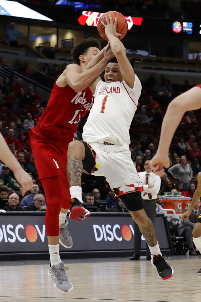Maryland's Anthony Cowan Jr. (1) is fouled by Nebraska's Isaiah Roby (15) during the second half of an NCAA college basketball game in the second round of the Big Ten Conference tournament, Thursday, March 14, 2019, in Chicago. (AP Photo/Nam Y. Huh)