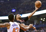 Toronto Raptors forward Norman Powell (24) drives to the net as New York Knicks forward Lance Thomas (42) looks on during first half NBA basketball action in Toronto, Monday, March 18, 2019. (Frank Gunn/The Canadian Press via AP)