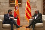 Spanish Prime Minister Pedro Sanchez, left, talks with Catalan regional President Quim Torra at the Palace of the Generalitat, the headquarter of the Government of Catalonia, in Barcelona, Thursday, Feb. 6, 2020. (AP Photo/Emilio Morenatti)