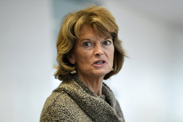 "FILE - In this March 19, 2020, file photo Sen. Lisa Murkowski, R-Alaska, talks with reporters following a Republican policy lunch on Capitol Hill in Washington. Murkowski acknowledged Thursday, June 4, that she's ""struggling"" over whether she can support President Donald Trump given his handling of the virus and race crises shaking the United States. (AP Photo/Susan Walsh, File)"