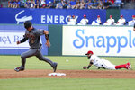 Arizona Diamondbacks Carson Kelly (18) rounds second as the ball hit by Jarrod Dyson gets past Texas Rangers second baseman Rougned Odor (12) in the first inning of a baseball game Wednesday, July 17, 2019, in Arlington, Texas. (AP Photo/Richard W. Rodriguez)