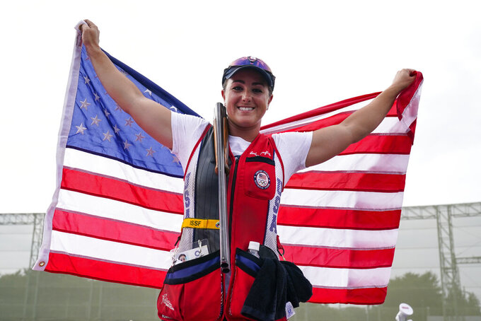 Amber English, of the United States, celebrates taking the gold medal in the women's skeet at the Asaka Shooting Range in the 2020 Summer Olympics, Monday, July 26, 2021, in Tokyo, Japan. (AP Photo/Alex Brandon)
