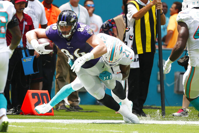 Miami Dolphins cornerback Eric Rowe (21) tackles Baltimore Ravens tight end Nick Boyle (86), during the first half at an NFL football game, Sunday, Sept. 8, 2019, in Miami Gardens, Fla. (AP Photo/Wilfredo Lee)