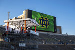 ESPN College Gameday hosts Davis, David Pollack and Kirk Herbstreit prepare for their live broadcast from Notre Dame Stadium before the NCAA college football game between the Notre Dame and the Clemson in South Bend, Ind. (Matt Cashore/Pool Photo via AP)