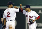 Boston Red Sox's Xander Bogaerts (2) and Mookie Betts, right, celebrate after the Red Sox defeated the Texas Rangers 4-2 in a baseball game Wednesday, July 11, 2018, in Boston. (AP Photo/Steven Senne)