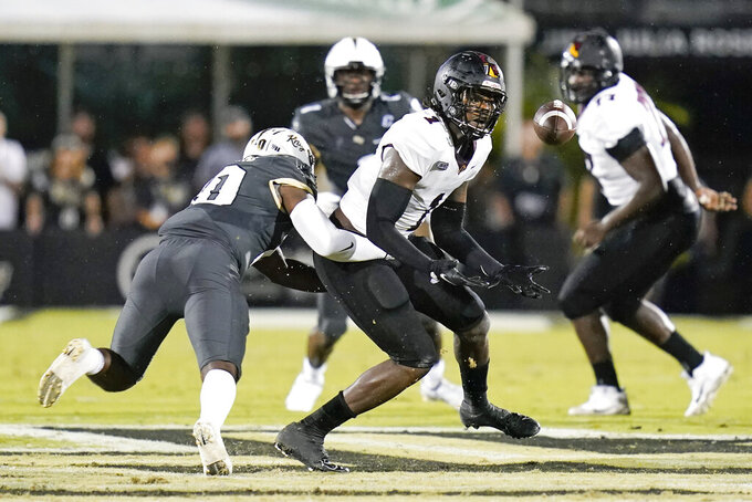 Central Florida linebacker Eriq Gilyard, left, breaks up a pass intended for Bethune-Cookman tight end Kemari Averett during the first half of an NCAA college football game, Saturday, Sept. 11, 2021, in Orlando, Fla. (AP Photo/John Raoux)