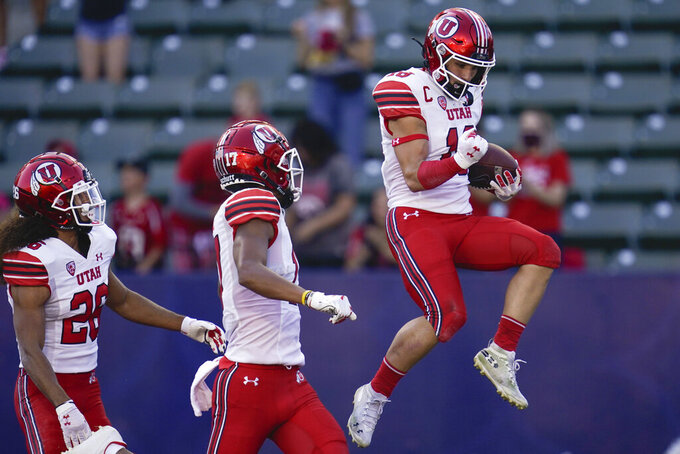 Utah wide receiver Britain Covey (18) celebrates after scoring a touchdown during the first half of an NCAA college football game against San Diego State Saturday, Sept. 18, 2021, in Carson, Calif. (AP Photo/Ashley Landis)