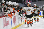 Anaheim Ducks center Rickard Rakell, right, celebrates with the bench after scoring a goal against the Minnesota Wild during the first period of an NHL hockey game Saturday, May 8, 2021, in St. Paul, Minn. (AP Photo/Craig Lassig)