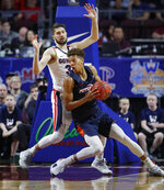 Pepperdine's Kessler Edwards drives into Gonzaga's Killian Tillie during the first half of an NCAA semifinal college basketball game at the West Coast Conference tournament, Monday, March 11, 2019, in Las Vegas. (AP Photo/John Locher)