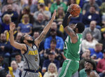 Boston Celtics guard Kyrie Irving (11) shoots over Indiana Pacers guard Cory Joseph (6) during the first half of an NBA basketball game in Indianapolis, Friday, April 5, 2019. (AP Photo/Michael Conroy)