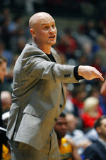 Southeastern Louisiana head coach David Kiefer signals his team during the first half of an NCAA college basketball game against Mississippi, Saturday, Dec. 21, 2019, in Jackson, Miss. Mississippi won 83-76. (AP Photo/Rogelio V. Solis)